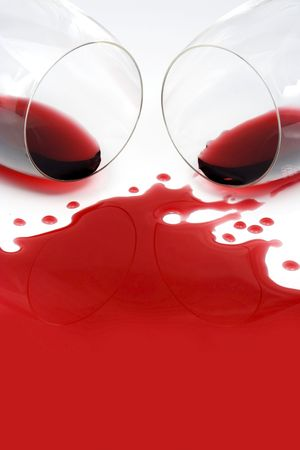 Red wine spilled from glasses photo