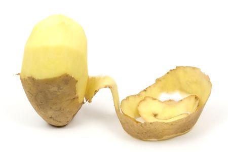peeled: One peeled potato isolated on white