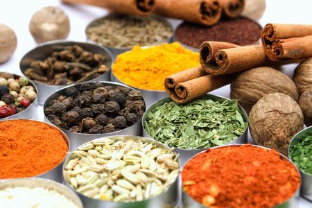 Assortment of various aromatic spices used for seasoning meals photo