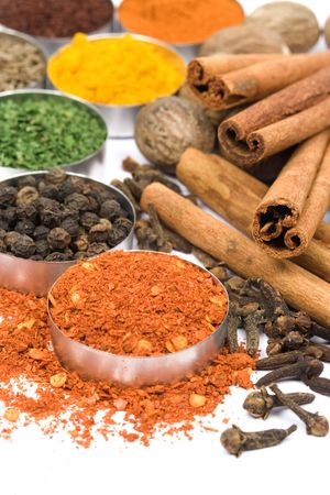 Ground red pepper and other indian spices photo
