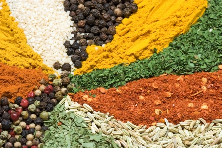 curry spices: Assortment of various colorful spices close up Stock Photo