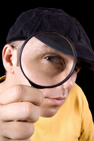 Investigator looking through magnifying glass photo