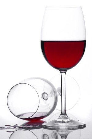 Two glasses of red wine on white background photo