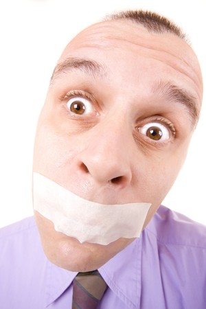 shutup: Confused businessman with taped mouth isolated on white