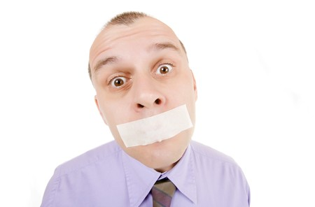 shutup: Businessman with duct taped mouth isolated on white background