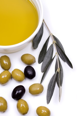 olive  oil: Olive oil with green and black olives on white background Stock Photo