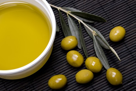 Extra virgin olive oil with green olives Stock Photo - 4564511