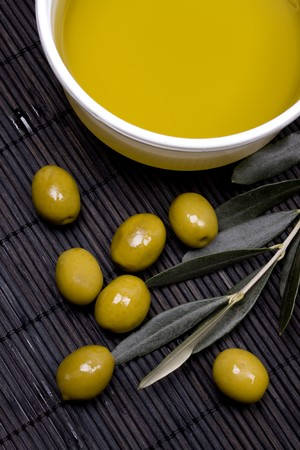 Extra virgin olive oil and green olives Stock Photo - 4564512