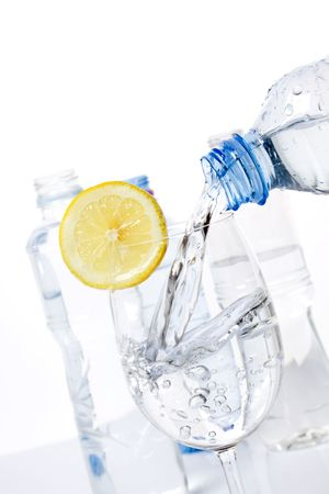 Glass of drinking water with lemon slice on white background Stock Photo