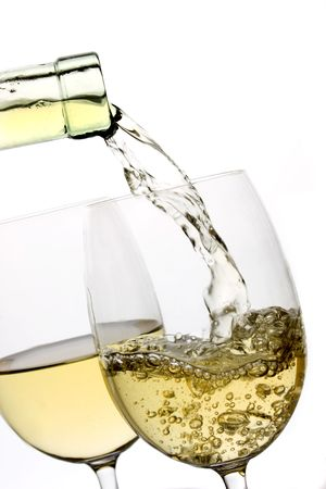 white wine glass: White wine poured in a glass over white background