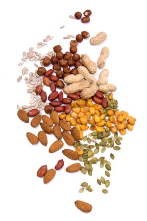 Healthy snack, nuts and seeds isolated on white background photo