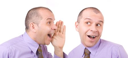 Business man telling a secret to himself isolated on white background