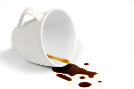 spills: Cup of coffee isolated on white background  Stock Photo