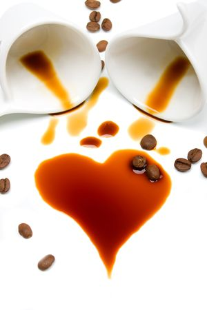 Heart shaped coffee stain isolated on white background photo