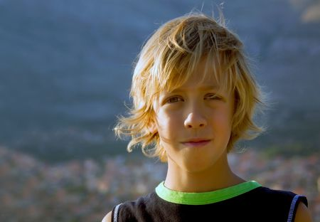 Beautiful young boy with long blond hair photo