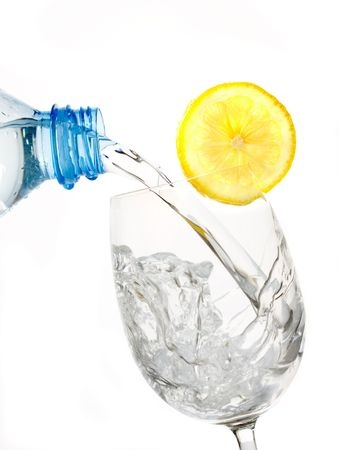 lemon water: Glass of drinking water with lemon slice isolated on white background