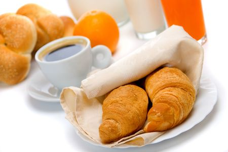 Fresh croissants with coffee, orange juice and milk Stock Photo
