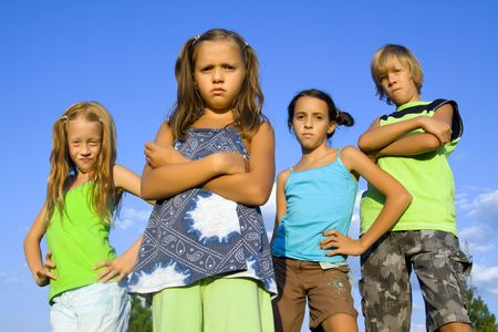 attitude girls: Gang of four kids with bad attitude Stock Photo