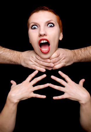 suffocate: Beautiful shocked woman isolated on black background Stock Photo
