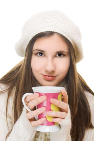 Young girl in winter outfit holding a cup of hot drink photo