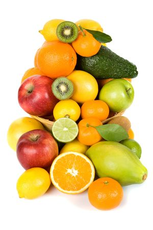 Basket full of fresh tropical fruit isolated on white background photo