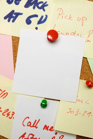 Blank paper note pinned on cork board Stock Photo - 6488088