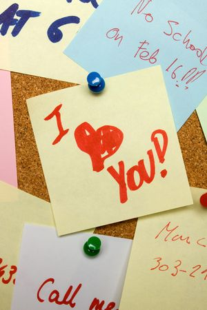 Love note pinned on cork notice board photo