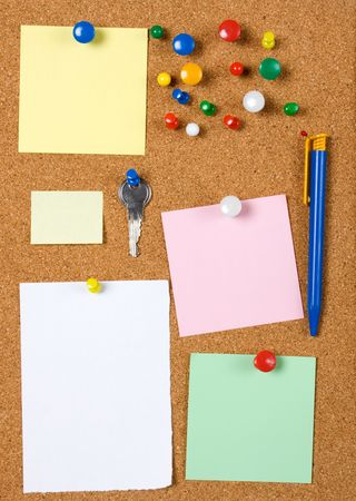 Blank memo notes pinned on cork notice board photo