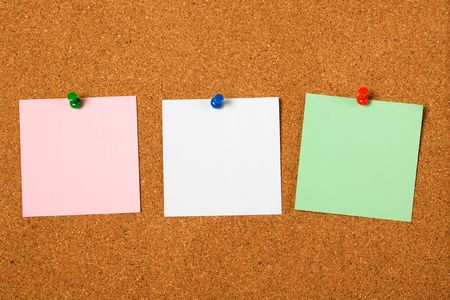 noteboard: Three blank notes pinned on cork notice board