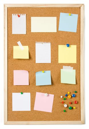Blank sticky notess pinned on cork notice board photo