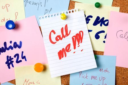 noteboard: Note saying call me pinned on notice board