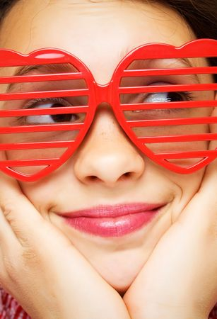 glass heart: Portrait of young girl with funny sunglasses