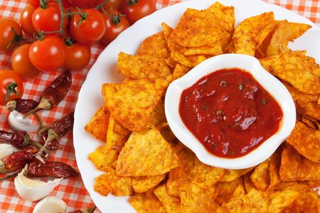 Tortilla chips with hot mexican salsa dip photo