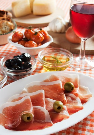 Prosciutto and olives served as antipasto, traditional italian appetizer Stock Photo - 6924380