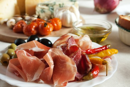 antipasto: Prosciutto and olives served as antipasto, traditional italian appetizer