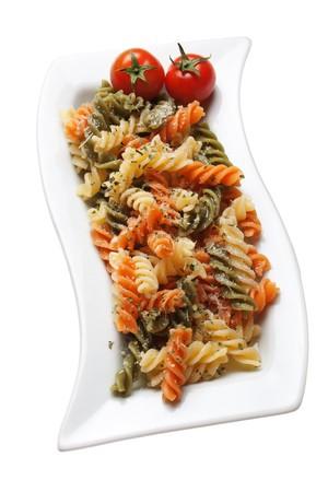 Italian tricolore pasta with cherry tomato isolated on white photo