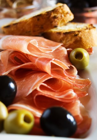 bruschetta: Prosciutto di Parma with olives and toasted bread Stock Photo