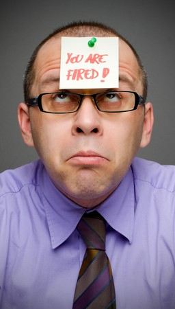 Middle aged businessman with note on his head