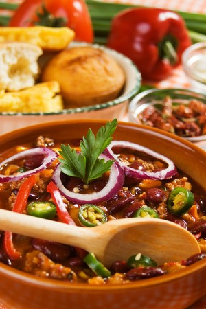 Authentic hot and spicy mexican chili beans served with corn bread photo