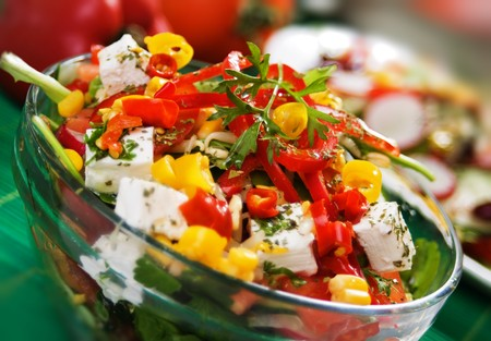 Delicious and nutritive cheese and pepperoni salad photo