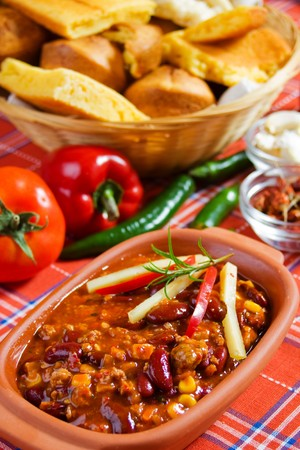Delicious mexican chili with kidney bean, corn and ground beef photo