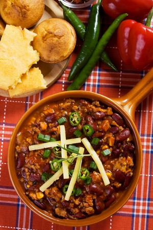 Traditional mexican chili beans con carne served with corn bread photo