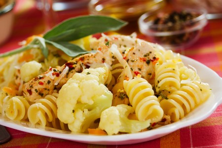 chicken meat: Italian tortiglioni pasta with cauliflower and chicken meat Stock Photo