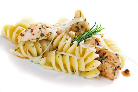 chicken meat: Italian pasta with chicken meat isolated on white background Stock Photo