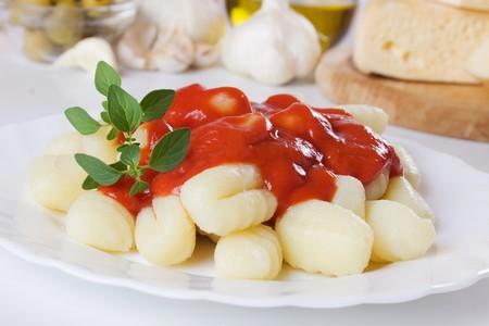 gnocchi: Gnocchi di patata, italian potato noodles with tomato sauce and oregano