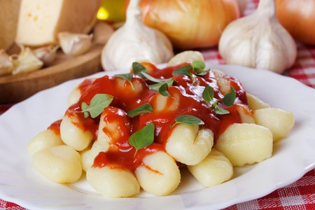 Gnocchi di patata, italian potato noodles with tomato paste and oregano