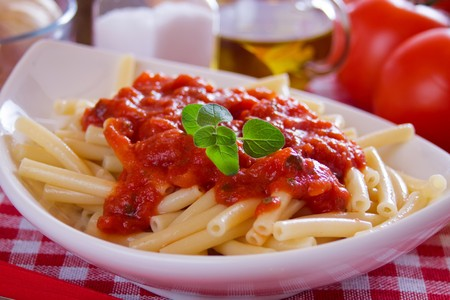 macaroni: Traditional italian macaroni pasta with tomato sauce and oregano Stock Photo