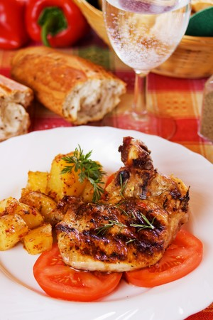 loin chops: Grilled pork loin chops with baked potato
