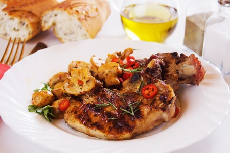 loin chops: Grilled pork loin chops with champignon mushrooms Stock Photo