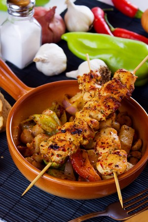 chicken meat: Grilled chicken meat on skewer served with vegetables Stock Photo